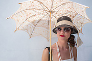 A woman in vintage costume on the Governors Island ferry on her way to the eighth annual Jazz Age Lawn Party.