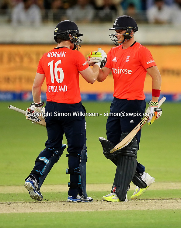 PICTURE BY MARK GREEN/SWPIX.COM  Pakistan v England 1st T20, Dubai Internayional Stadium, UAE, 26/11/15 <br /> England Captain Eoin Morgan comgratulates Sam Billings on reaching his 50