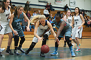 South Burlington's Allie Bosley (12) and Burlington's Riley Janeway (31) battle for the loose ball during the girls basketball game between the South Burlington Rebels and the Burlington Sea Horses at Burlington High School on Tuesday night Febraury 2, 2016 in Burlington. (BRIAN JENKINS/for the FREE PRESS)