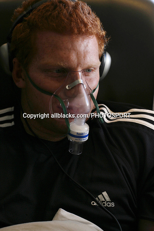 All Blacks lock James Ryan wears a 'Humidiflyer' - a mask designed to catch the moisture from his breath and re-humidify the air he breathes in on board an Air New Zealand flight to London for the European Tour, on Sunday 29 October 2006. Photo: Marc Weakley/allblacks.com<br /> <br /> <br /> 291006