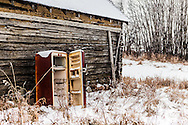 Refrigerator In Snow by log cabin, Alberta Canada