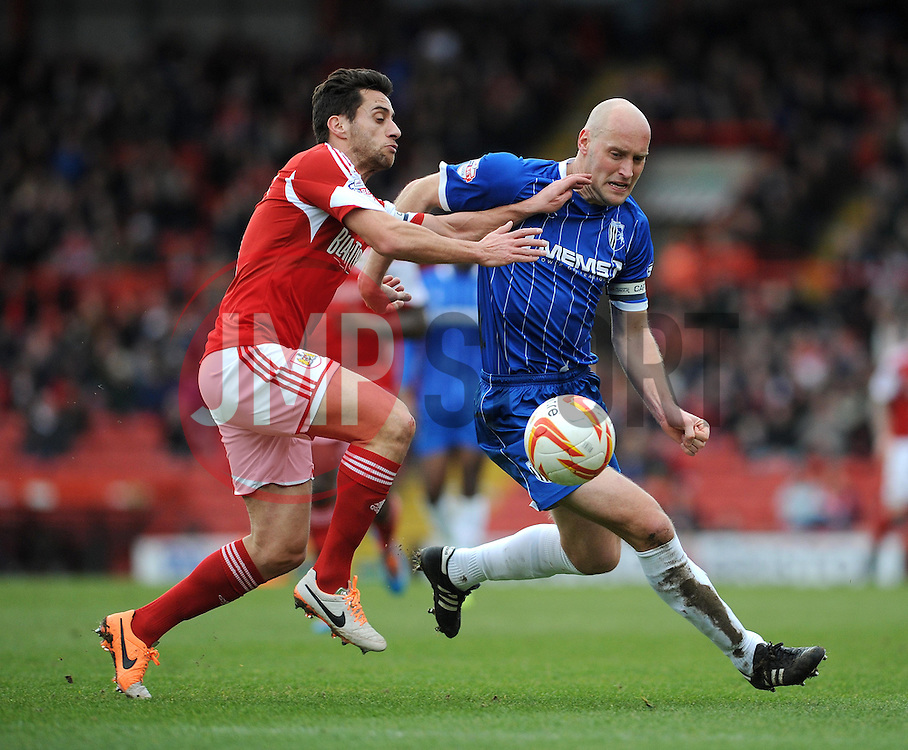Bristol City's Sam Baldock challenges Gillingham's Adam Barrett - Photo mandatory by-line: Dougie Allward/JMP - Tel: Mobile: 07966 386802 01/03/2014 - SPORT - FOOTBALL - Bristol - Ashton Gate - Bristol City v Gillingham - Sky Bet League One