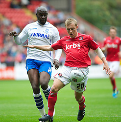 LONDON, ENGLAND - Saturday, October 8, 2011: Tranmere Rovers' Enoch Showunmi and Charlton Athletic's Chris Solly in action during the Football League One match at The Valley. (Pic by Gareth Davies/Propaganda)