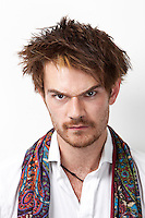 Portrait of an angry young man against white background
