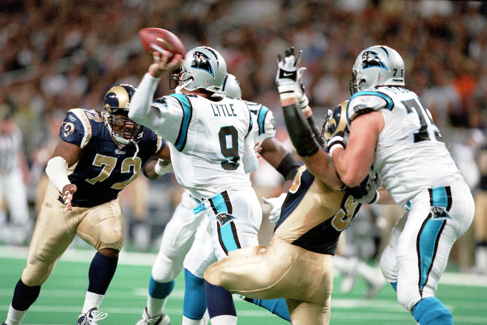 Quarterback Matt Lytle (9) of the Carolina Panthers throws a pass under pressure from Defensive End Chidi Ahanotu (72) of the St. Louis Rams during a 48 to 14 win by the Rams on 11/11/2001..©Wesley Hitt/NFL Photos