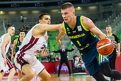 Edo Muric of Slovenia and Andrejs Grazulis of Latvia during basketball match between National teams of Slovenia and Latvia in Round #10 of FIBA Basketball World Cup 2019 European Qualifiers, on December 2, 2018 in Arena Stozice, Ljubljana, Slovenia. Photo by Grega Valancic
