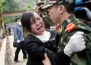 Liu Li  weeps as she is reunited with her brother Liu Wei for the first time since the earthquake.