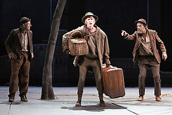"© Licensed to London News Pictures. 05/06/2015. London, UK. L-R: Richard Roxburgh as Estragon, Luke Mulllins as Lucky and Hugo Weaving as Vladimir. Actors Richard Roxburgh and Hugo Weaving star in Samuel Beckett's ""Waiting for Godot"" at the Barbican Theatre. Part of the International Beckett Season, this Sydney Theatre Company play is directed by Andrew Upton. With Luke Mullins as Luke, Philip Quast as Pozzo, Richard Roxburgh as Estragon and Hugo Weaving as Vladimir. Performances from 4 to 13 June 2015 at the Barbican Theatre. Photo credit : Bettina Strenske/LNP"