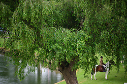 © Licensed to London News Pictures. 12/05/2017. Windsor, UK.  A horse being exercised along the banks of the River Thames on day three of the Royal Windsor Horse show. The five day equestrian event takes place in the grounds of Windsor Castle. Photo credit: Ben Cawthra/LNP