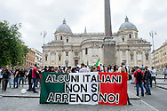 Roma 12 Luglio 2014<br /> Manifestazione  del movimento di estrema destra  Casapound, contro immigrazione per chiedere la chiusura dei centri di accoglienza e lo sgombero degli insediamenti abusivi dei rom.<br /> Rome July 12, 2014 <br />  A demonstration was held in downtown Rome  of the far-right movement Casapound against immigration to demand the closure of shelters and the evacuation of the settlements of Roma.