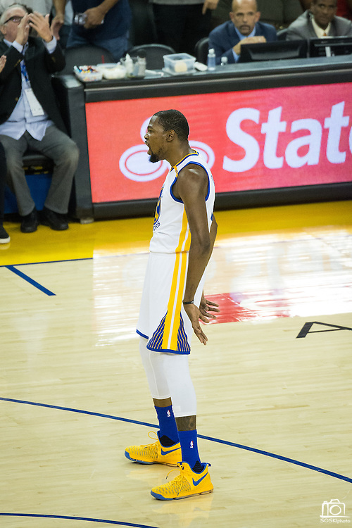 Golden State Warriors forward Kevin Durant (35) celebrates after scoring a three pointer against the Oklahoma City Thunder at Oracle Arena in Oakland, Calif., on November 3, 2016. (Stan Olszewski/Special to S.F. Examiner)