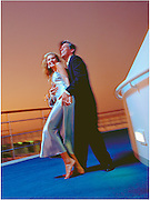 Young couple dancing on ship deck at twilight