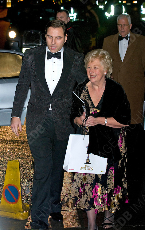 19.DECEMBER.2011. LONDON<br /> <br /> DAVID WALLIAMS WITH HIS MOTHER AT THE SUN MILITARY AWARDS 2011 AT THE IMPERIAL WAR MUSEUM IN LONDON<br /> <br /> BYLINE: EDBIMAGEARCHIVE.COM<br /> <br /> *THIS IMAGE IS STRICTLY FOR UK NEWSPAPERS AND MAGAZINES ONLY*<br /> *FOR WORLD WIDE SALES AND WEB USE PLEASE CONTACT EDBIMAGEARCHIVE - 0208 954 5968*