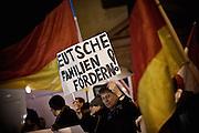 Frankfurt am Main | 02 Feb 2015<br /> <br /> Am Montag (02.02.2015) demonstrierten in Frankfurt an der Hauptwache etwa 60 PEGIDA-Anh&auml;nger mit teils extrem rassistischen Reden und Parolen z.B: gegen &quot;Islamisierung&quot;, an den Aktionen gegen die Rechtsextremisten nahmen mehrere tausend Menschen teil.<br /> Hier: PEGIDA-Aktivist mit einem kleinen Plakat mit der Aufschrift 'Deutsche Familien f&ouml;rdern'.<br /> <br /> &copy;peter-juelich.com<br /> <br /> [No Model Release | No Property Release]