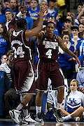 Mississippi State guard Tyson Cunningham, left, congratulates guard Trivante Bloodman after being fouled and making a shot in the first half. The University of Kentucky Men's Basketball team hosted Mississippi State , Wednesday, Feb. 27, 2013 at Rupp Arena in Lexington .