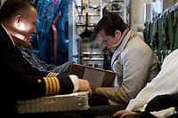 30 NOV 2010, JAGEL/GERMANY:<br /> Karl-Theodor zu Guttenberg, CSU, Bundesverteidigungsminister, liest in seinen Unterlagen, waehrend dem Flug mit einer Transall zum Fliegerhorst Jagel anl. der  Rueckkehr der in Afghanistan eingesetzten RECCE TORNADO Aufklaerungsjets<br /> IMAGE: 20101130-01-006<br /> KEYWORDS: Bundeswehr, Armee, Luftwaffe, lesen