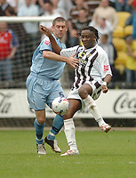 Photo: Leigh Quinnell.<br /> Notts County v Bury. Coca Cola League 2. 06/05/2006.<br /> Burys David Challinor battles with Notts Countys Eugene Dadi.