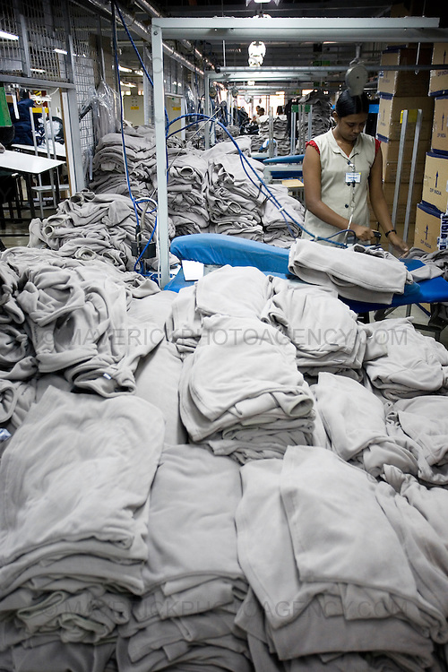 General views of a clothing factory in Colombo, Sri Lanka which manufactures goods for export to western markets. Pictured a factory worker presses fleece sweatshirts.
