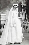 girl posing to commemorate her holy communion vintage studio portrait