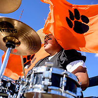 Gallup High School senior Adriano Yazzie plays the drums for the Bengal marching band for the GHS homecoming parade in Gallup Friday.