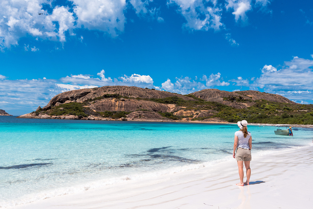 Lucky Beach, Esperance, Australia--February 9, 2018. A woman is standing on the beach at Lucky Bay in Esperance, Australia. Editorial Use Only.