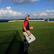 The A's Steven Greenberg gets in some pregame running before a game in July in Clarinda.  photo by David Peterson