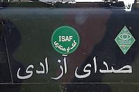 26 SEP 2004, KUNDUZ/AFGHANISTAN:<br /> ISAF Zeichen mit arabischen Schriftzeichen auf einer Fahrzeugtuere, Provincial Reconstruction Team des Deutsche Einsatzkontingents ISAF, PRT ISAF, Lager Kunduz<br /> IMAGE: 20040926-01-107<br /> KEYWORDS: Reise, Bundeswehr, Auslandseinsatz, Schild, sign, Logo,