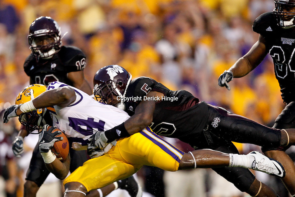 Sep 18, 2010; Baton Rouge, LA, USA;  Mississippi State Bulldogs safety Nickoe Whitley tackles LSU Tigers running back Stevan Ridley (34) during the first half at Tiger Stadium.  Mandatory Credit: Derick E. Hingle