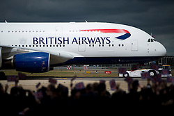 04/07/2013 . London, UK.  British Airways staff wave union flags as the new British Airways Boeing A380 superjumbo arrives at Heathrow Airport. It was the first time British Airlines have taken delivery of the new plane, making British Airways the first European airline to operate both the 787 and A380. Photo credit : Ben Cawthra/