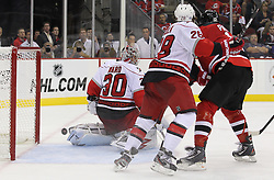 Oct 10; Newark, NJ, USA; New Jersey Devils defenseman Mark Fayne (29) scores a goal past Carolina Hurricanes goalie Cam Ward (30) during the second period at the Prudential Center.