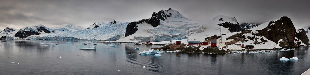Panorama of Paradise Harbor and Brown Station (Estación Científica Almirante Brown) in Antarctica from the Deck of the Hurtigruten MS Fram. Composite of 16 image takens with a Fuji X-T1 camera and Zeiss 32 mm f/1.8 lens (ISO 200, 32 mm, f/16, 1/500 sec). Raw images processed with Capture One Pro, Focus Magic, Photoshop CC 2015, and AutoPano Giga Pro