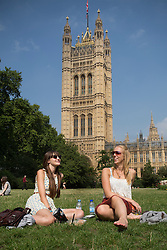 © licensed to London News Pictures. London, UK 04/09/2013. People enjoying the sunshine at Victoria Tower Gardens in central London on Tuesday, September 4, 2013. Photo credit: Tolga Akmen/LNP
