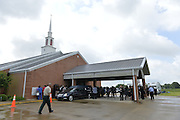 "5/30/15 Indianola  Friends,family and fans arrive at B B King's funeral service.  ""See That My Grave Is Kept Clean"" one of BB Kings famous songs forecast his funeral procession complete with two white horses and a black horse flanked with two signed Gibson guitars. Fans lined the street to see B.B. Kings final homecoming and pay their respect. Photo ©Suzi Altman"