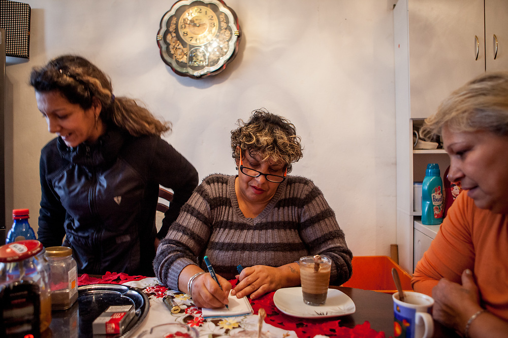 Maria (52), her daughter (left) and friend Darina in her flat in one of the buildings which is in a better condition then many others and has heating, electricity and water. When Maria was living from social welfare she decided herself to open a little grocery store at Lunik IX to be independent and to earn her own money, she and her husband are running for years their own business succesfully.
