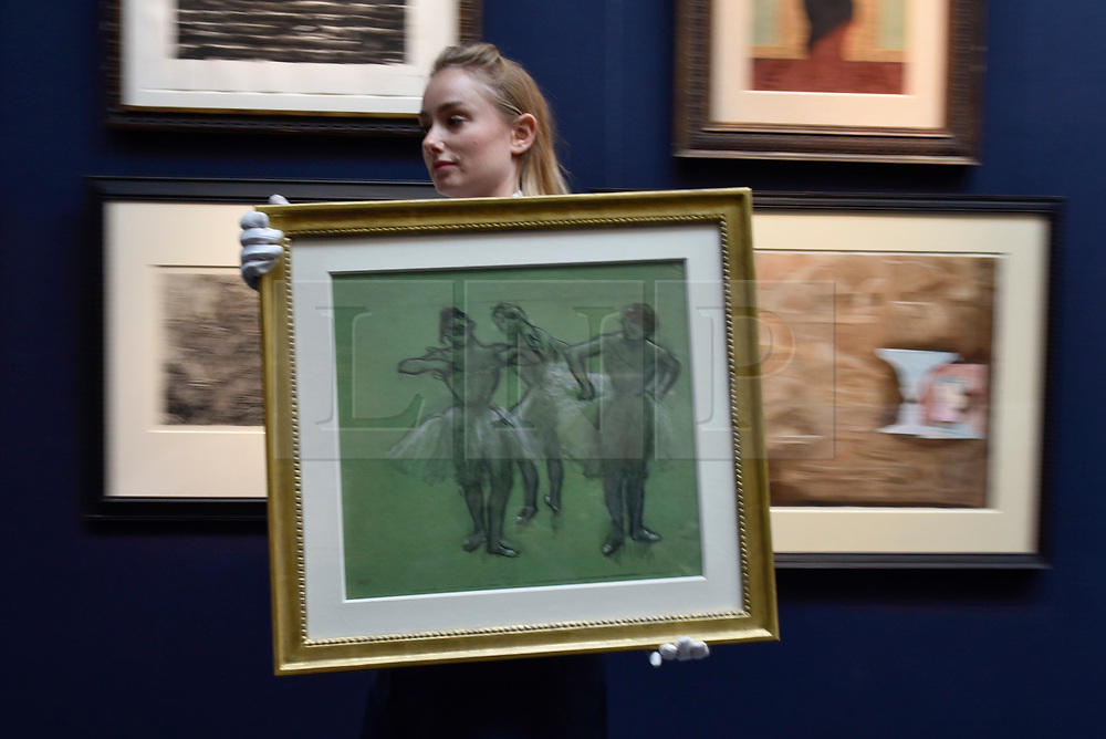 "© Licensed to London News Pictures. 06/10/2017. London, UK. A technician carries ""Trois Danseuses"", 1889, by Edgar Degas at a preview at Sotheby's in New Bond Street of contemporary, impressionist and modern art works to be auctioned in New York in November 2017 Photo credit : Stephen Chung/LNP"