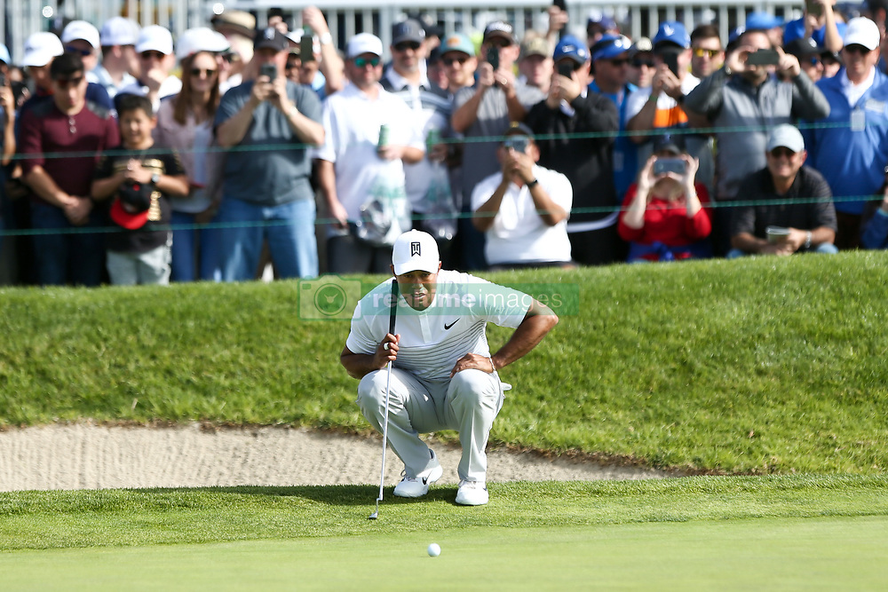 January 27, 2018 - San Diego, California, United States - Tiger Woods lines up a putt on the 18th green during the third round of the 2018 Farmers Insurance Open at Torrey Pines GC. (Credit Image: © Debby Wong via ZUMA Wire)