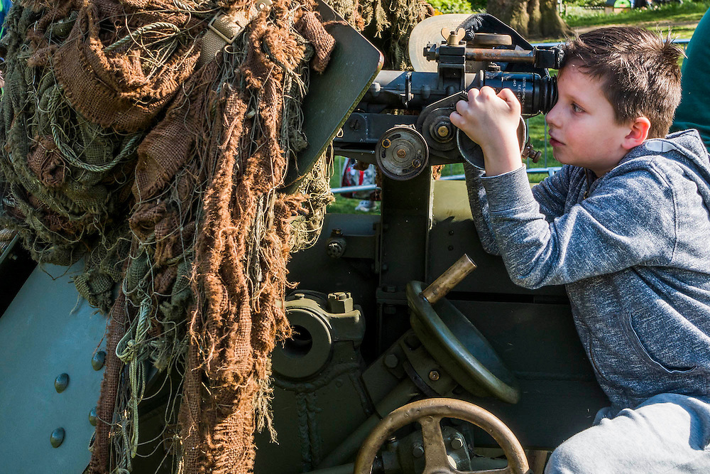 A Russian boy has a go at aiming a 17 pounder anti-tank gun in St James Park. VE Day 70 commemorations - Three days of events in London and across the UK marking historic anniversary of end of the Second World War in Europe. Trafalgar Square, scene of jubilant celebrations marking the end of the Second World War in Europe on 8 May 1945, plays a central part in a host of national events, which include a Service of Remembrance at the Cenotaph, a concert in Horse Guards Parade, a Service of Thanksgiving at Westminster Abbey, a parade of Service personnel and veterans and a flypast.
