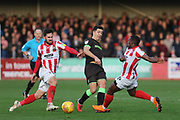 Chris Clements, Lloyd James and Alex Addai  during the EFL Sky Bet League 2 match between Cheltenham Town and Forest Green Rovers at LCI Rail Stadium, Cheltenham, England on 29 December 2018.