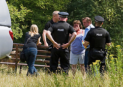 © licensed to London News Pictures. 15/07/2011. Maidenhead, UK. Emotional Family of Michael Payne being comforted at the scene.  Police divers from a search and rescue team searching Cookham Lock near Maidenhead, Berkshire today (15/07/2011) where 59 year-old Michael Payne went into the river trying to save his teenage daughter Zoe. Zoe was pulled to safety, but Mr Payne dissapeared beneath the surface , watched by his partner and two daughters. Photo credit should read Ben Cawthra/LNP