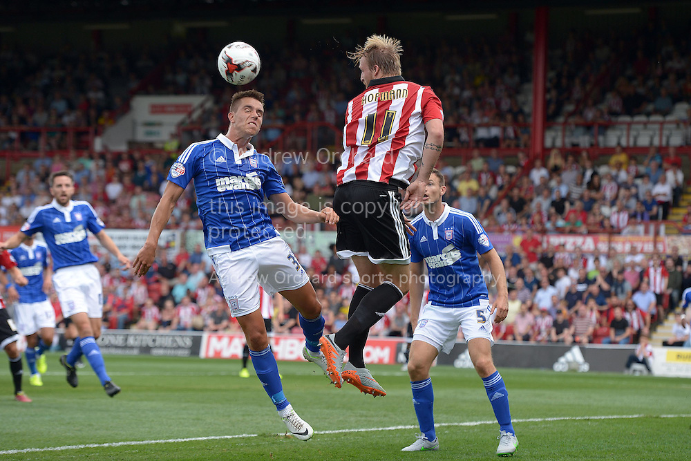 Jonas Knudsen of Ipswich Town heads the ball out for a corner to Brentford. Skybet football league Championship match, Brentford v Ipswich Town at Griffin Park in London on Saturday 8th August 2015.<br /> pic by John Patrick Fletcher, Andrew Orchard sports photography.