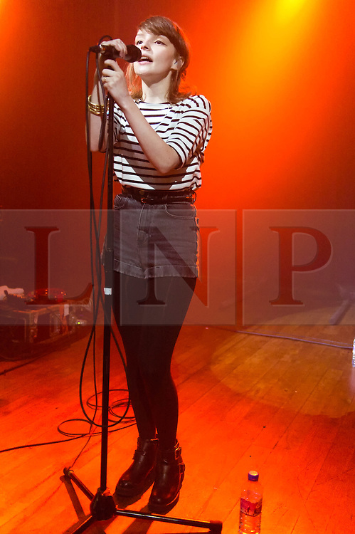 """© Licensed to London News Pictures. 17/02/2014. London, UK.   Chvrches performing live at Scala. Chvrches (pronounced as """"churches"""", sometimes stylised as CHVRCHES or CHVRCHΞS) is a British synthpop band, formed in 2011. The group consists of Lauren Mayberry (lead vocals, additional synthesisers and samplers), Iain Cook (synthesisers, guitar, bass, vocals), and Martin Doherty (synthesisers, samplers, vocals).  Chvrches came fifth on the BBC's Sound of 2013 list.  Photo credit : Richard Isaac/LNP"""