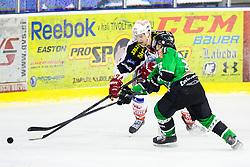 28.02.2014, Hala Tivoli, Ljubljana, SLO, EBEL, HDD Telemach Olimpija Ljubljana vs EC KAC, 77th Game Day, in picture Jamie Lundmark (EC KAC, #74) vs Jure Sotlar (HDD Telemach Olimpija, #33) during the Erste Bank Icehockey League 77th Game Day match between HDD Telemach Olimpija Ljubljana and EC KAC at the Hala Tivoli, Ljubljana, Slovenia on 2014/02/28. (Photo By Matic Klansek Velej / Sportida)