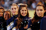 Milpitas High School cheerleaders look on during the National Anthem before the kickoff against Woodside at Milpitas High School in Milpitas, California, on September 13, 2013. (Stan Olszewski/SOSKIphoto)