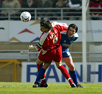 Photo: Chris Ratcliffe.<br />Leyton Orient v Boston United. Coca Cola League 2. 08/04/2006.<br />John Mackie (L) of Leyton Orient takes on Mark Greaves of Boston United