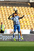Dominic Iorfa beats Kazenga LuaLua to a header during the Sky Bet Championship match between Wolverhampton Wanderers and Brighton and Hove Albion at Molineux, Wolverhampton, England on 19 September 2015. Photo by Alan Franklin.