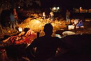A Community Police (backwards, silhouetted) monitors prisoners in their reeducation program. Reeducation means the repair of damages done by antisocial behaviors, such as theft, murder, kidnapping even witchcraft by working for the community. The reeducation also contemplates psychological support and talks with elder men.  / Un policÌa comunitario (silueteado, de espaldas) vigila a detenidos mientras trabajan en su programa de reeducación. La reeducaciÛn implica la reparación del daño por conductas antisociales, como robo, asesinato, secuestro e incluso brujería, con trabajos para la comunidad. La reeducación también contempla apoyo psicológico y pláticas con ancianos. (Photo:  Prometeo Lucero)