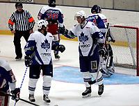 Fotball , 3. juni 2006, Toppserien kvinner , Asker - Fortuna , Teemu Kuusisto (til venstre) har lagt på til 3-2 for Furuset og blir gratulert av Andreas Bogstad Foto: Kasper Wikestad