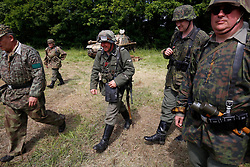 © Licensed to London News Pictures. 27/04/2018. Denmead, UK. Participants, dressed in German military uniform, take part in the Overlord Military Spectacular, a gathering of military re-enactors. The event, 1st held in 1977, is organised by The Solent Overlord Military Collectors Club and features some 200 military vehicles and 500 re-enactors dressed in authentic uniforms and equipment from the era.   Photo credit: Julian Herbert/LNP