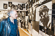 The Board Room where business cards from arms manufacturers are shown with images of war. Peter Kennard: Unofficial War Artist - Retrospective Exhibition of British Political and anti-war artist at IWM London, UK 12 May 2015