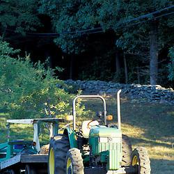 Bolton, MA.  USA.  A tractor on the Schartner Farm in Massachusetts' Nashoba Valley.  Apple orchard.